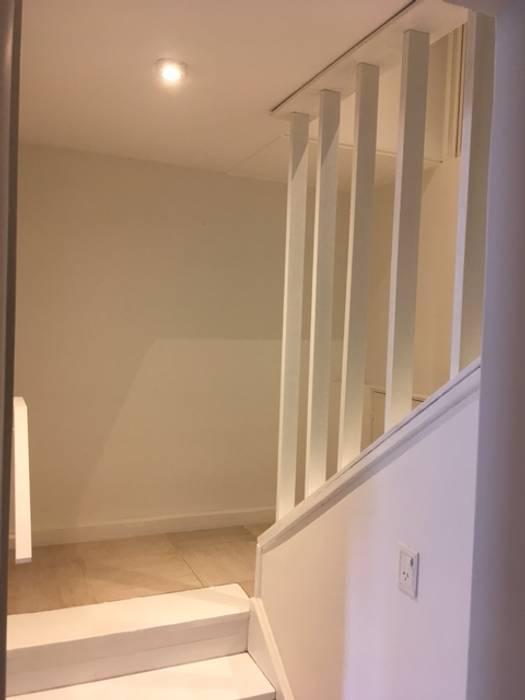 escalera: Escaleras de estilo  por FAARQ - Facundo Arana Arquitecto & asoc.,Ecléctico