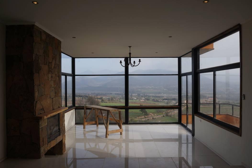 Vista desde living. Livings de estilo moderno de Uno Arquitectura Moderno Piedra