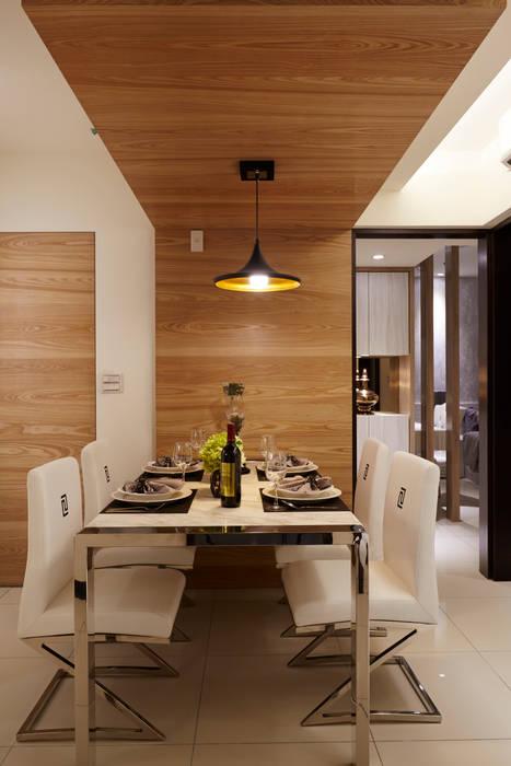 餐桌為石材與不鏽鋼共構:  飯店 by 雅和室內設計