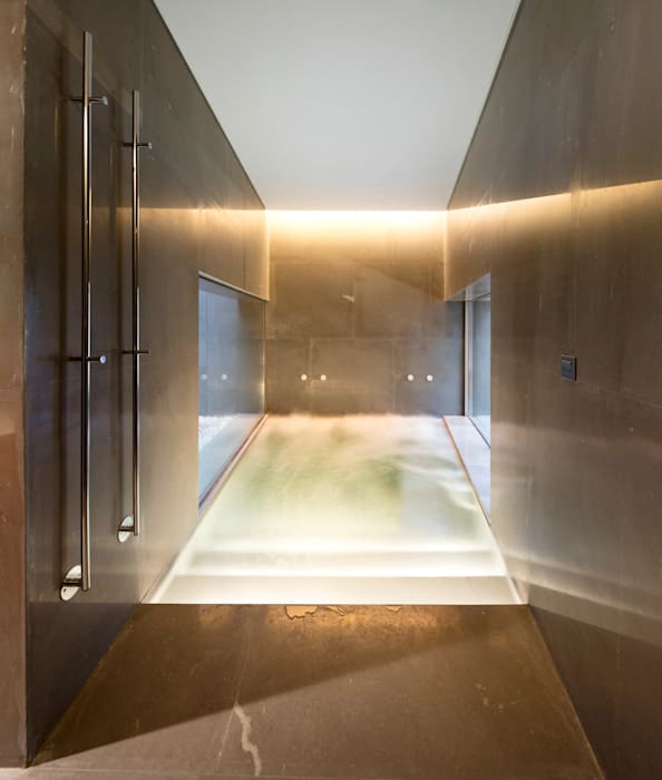 SPA : Saunas de estilo  de AGi architects