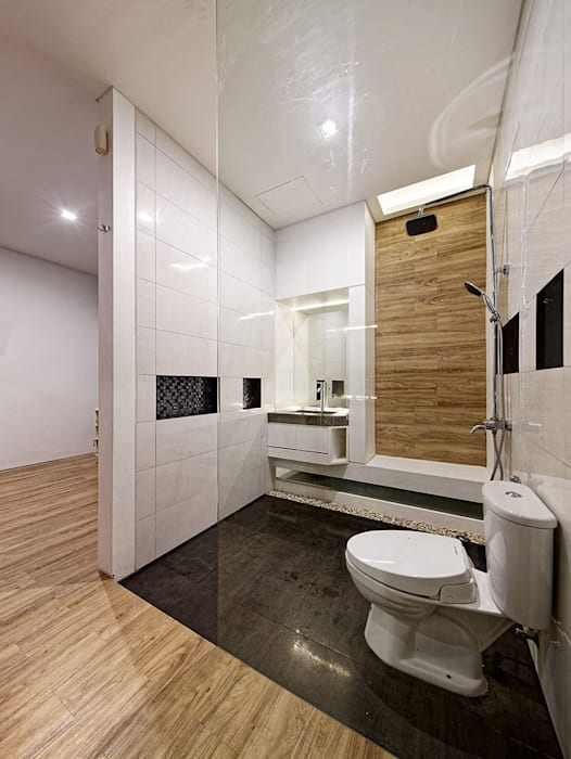 Phòng tắm thứ hai của ngôi nhà:  Phòng tắm by Công ty TNHH TK XD Song Phát