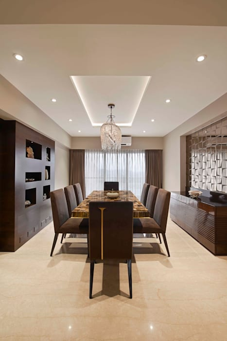 The Warm Bliss:  Dining room by Ar. Milind Pai,Minimalist Marble