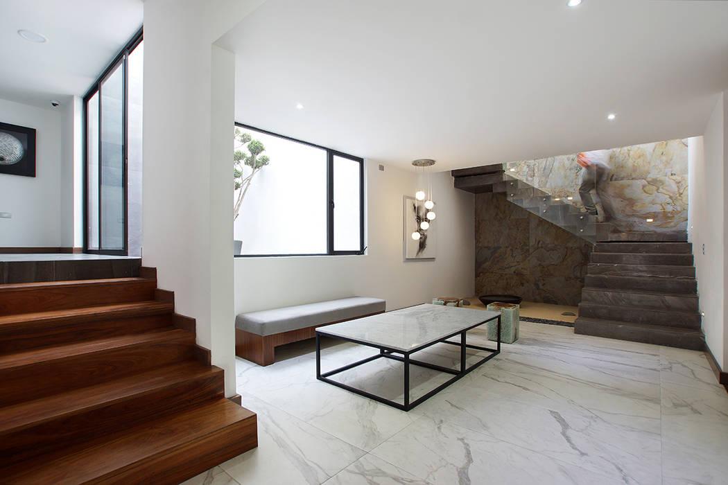 Pasillos, halls y escaleras minimalistas de Dionne Arquitectos Minimalista