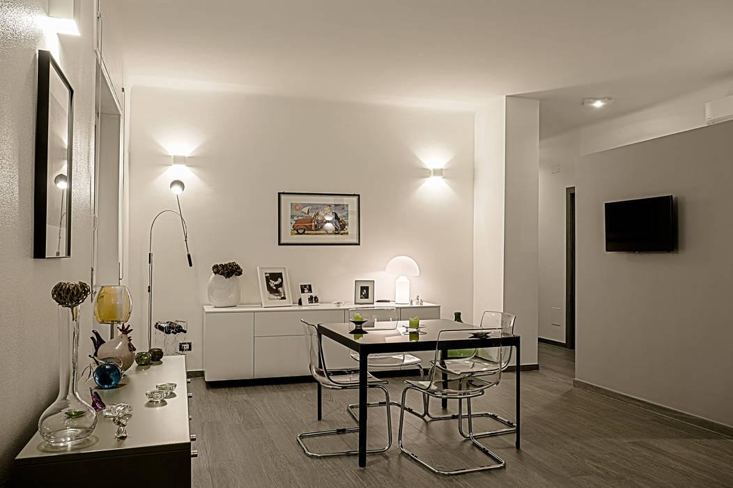 Stanza da pranzo e quinta multifunzione: Sala da pranzo in stile in stile Moderno di Rosa Gorgoglione Architetto