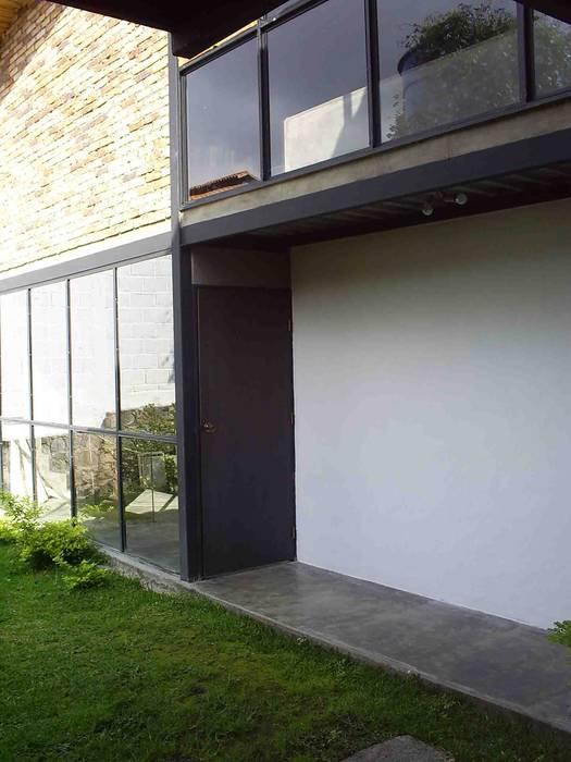 Fachada Atis Proyectos Casas de campo Concreto Blanco
