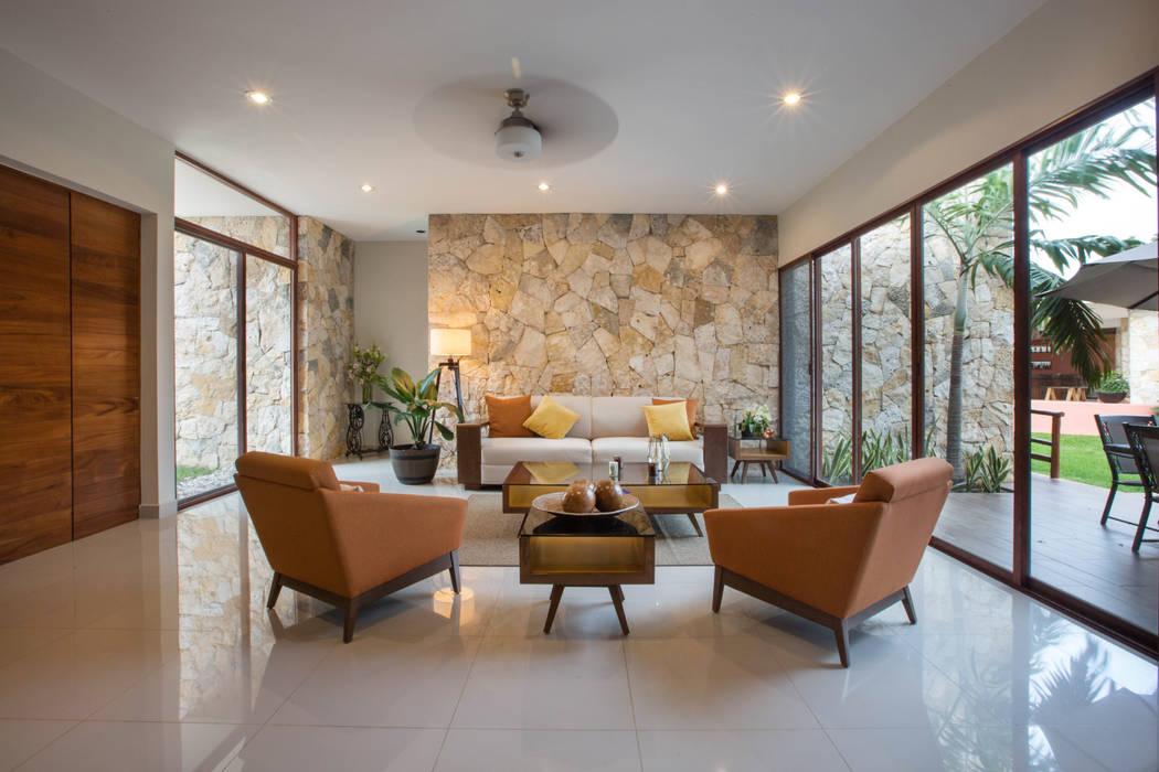 Salones de estilo  de Heftye Arquitectura, Moderno Caliza