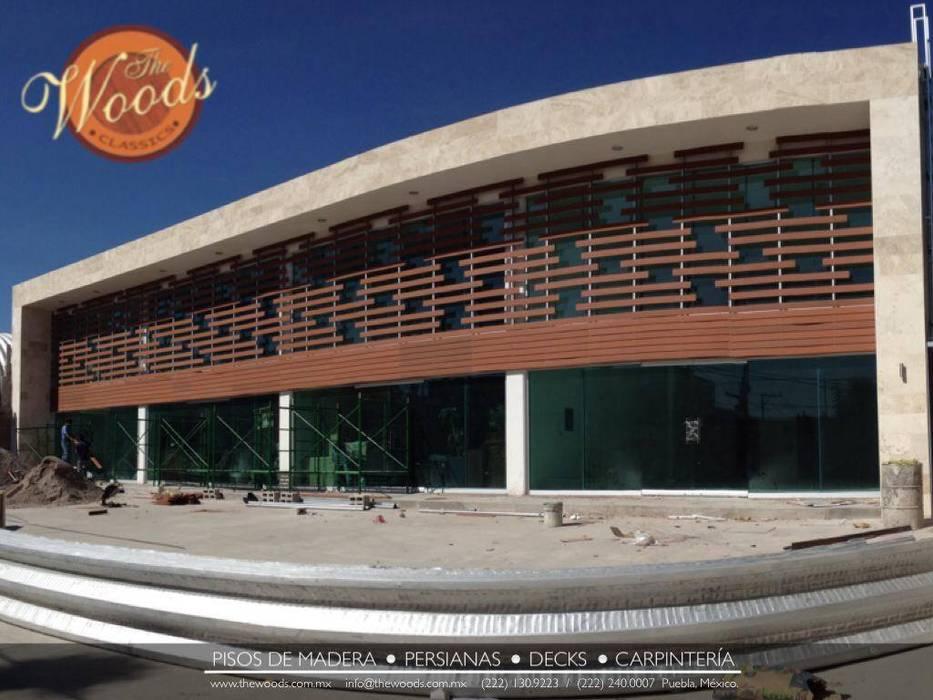 Fachada de centro comercial de Kiinch Clásico Compuestos de madera y plástico