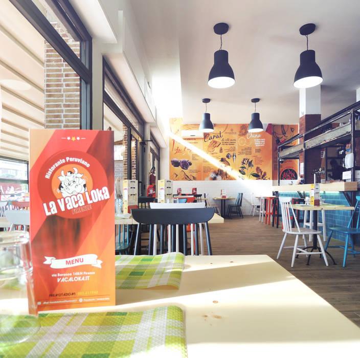 Restaurant  la Vaca Loka: Negozi & Locali commerciali in stile  di Studio Gentile