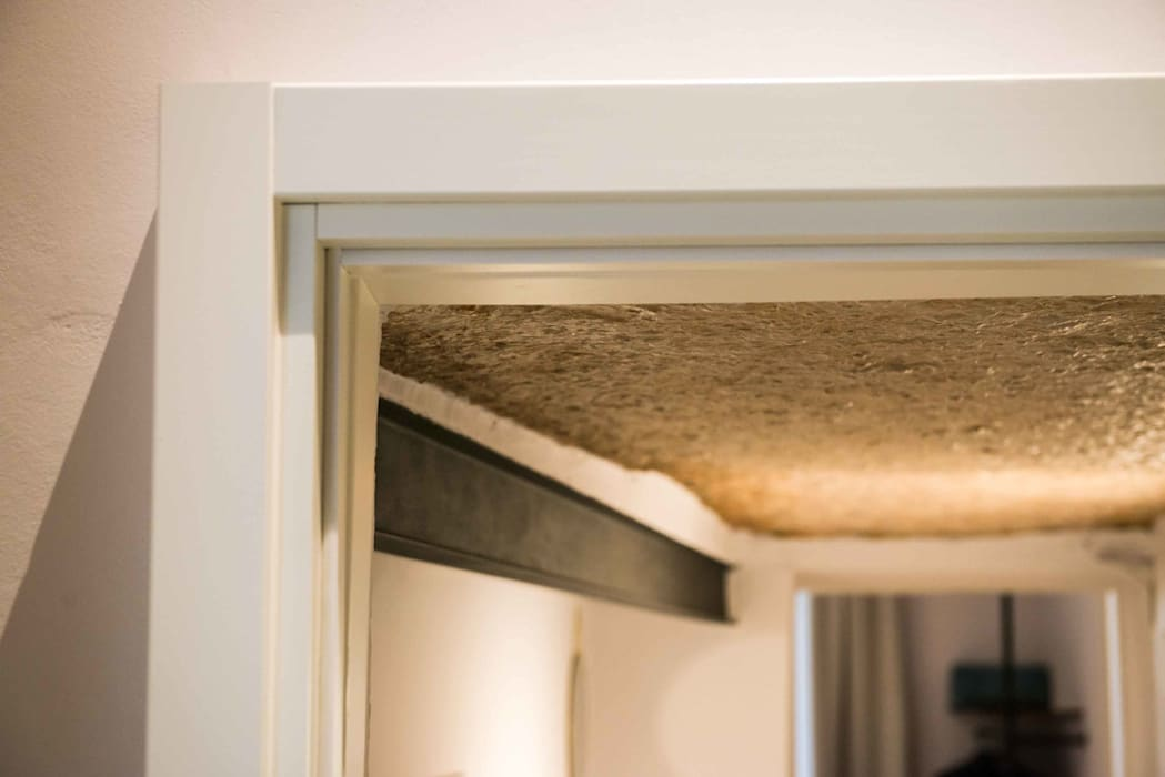 SOTTOSCALA: Ingresso & Corridoio in stile  di PADIGLIONE B