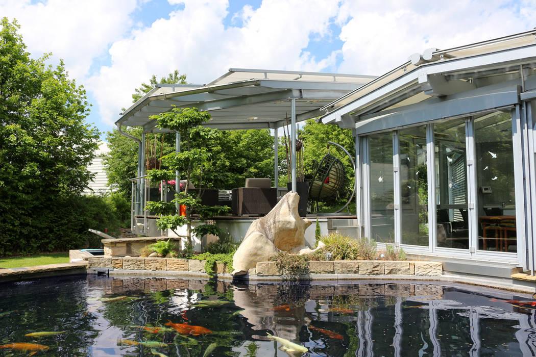 Asian style conservatory by RAUCH Gaten- und Landschaftsbau GbR Asian