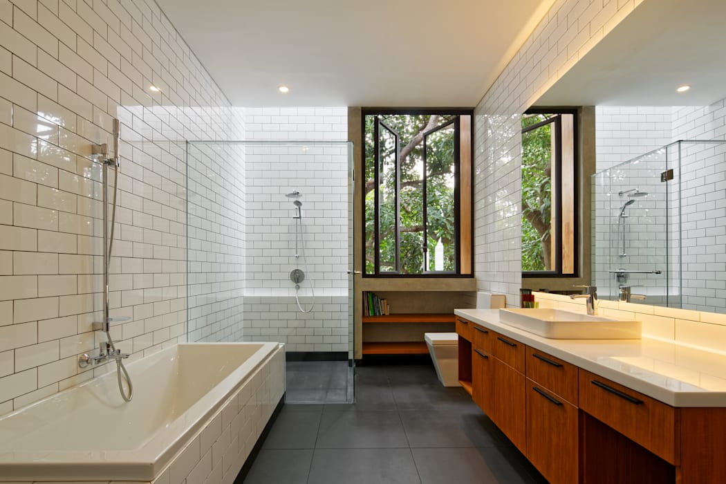 House of Inside and Outside Tropical style bathrooms by Tamara Wibowo Architects Tropical Ceramic