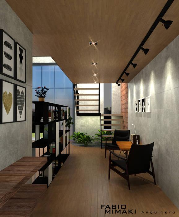 Salas de estilo industrial de Fabio Mimaki Arquitetura Industrial Concreto