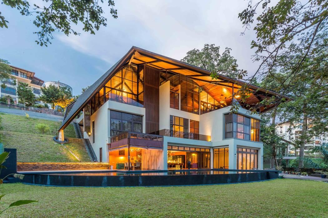MJ Kanny Architect Casas de estilo tropical
