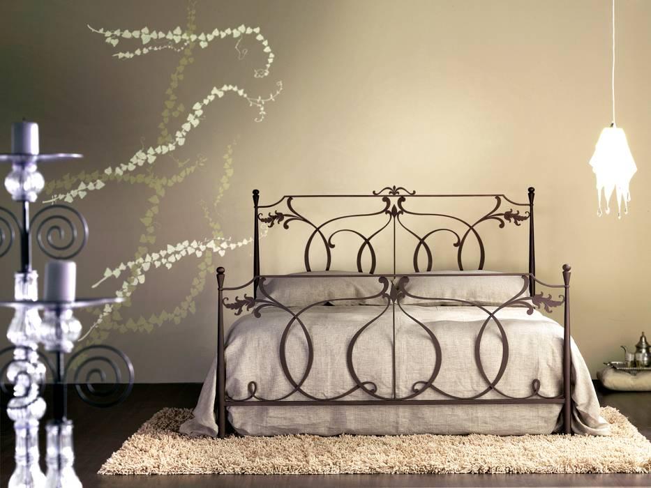 Letto matrimoniale in ferro battuto: camera da letto in stile di ...