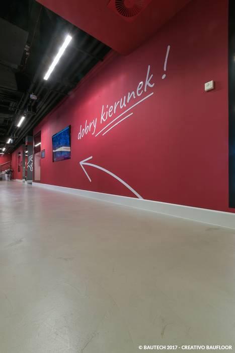 Klub Sportowy Fabryka Formy : styl , w kategorii Podłogi zaprojektowany przez Bautech Sp. Z O.O.,Nowoczesny Beton