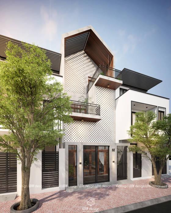 Cảm xúc Á Đông - Nhà phố Sài Gòn:  Nhà by LEAF Design ,