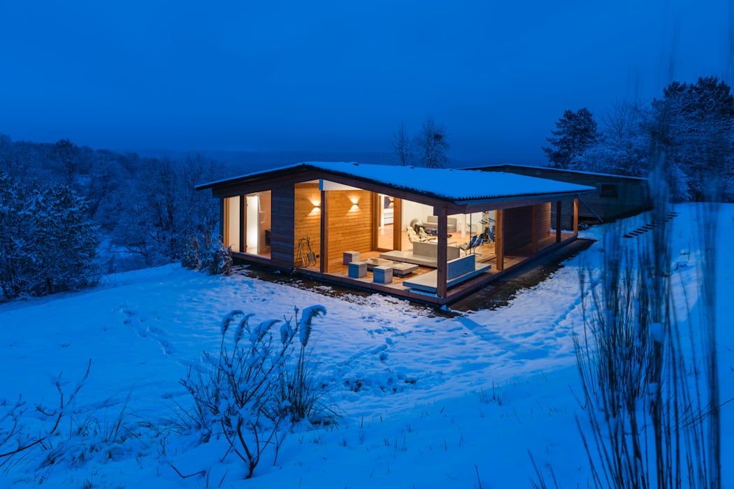 Casas de estilo moderno de Karl Kaffenberger Architektur | Einrichtung Moderno Madera Acabado en madera
