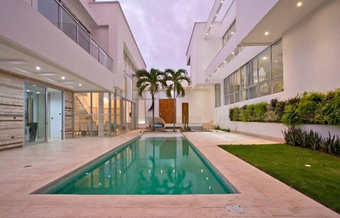 Casa MG: Piscinas de estilo  por Cabas/Garzon Arquitectos