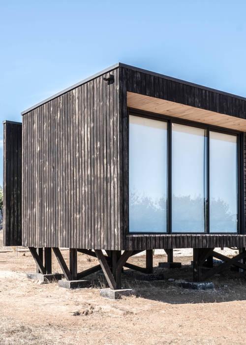 casa tunquen: Casas de madera de estilo  por GZ Fotografia