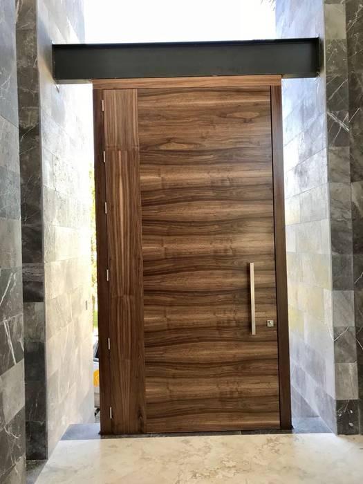 fotos de puertas principales de madera modernas Puerta Principal Casas Modernas De Grupo Volta Moderno