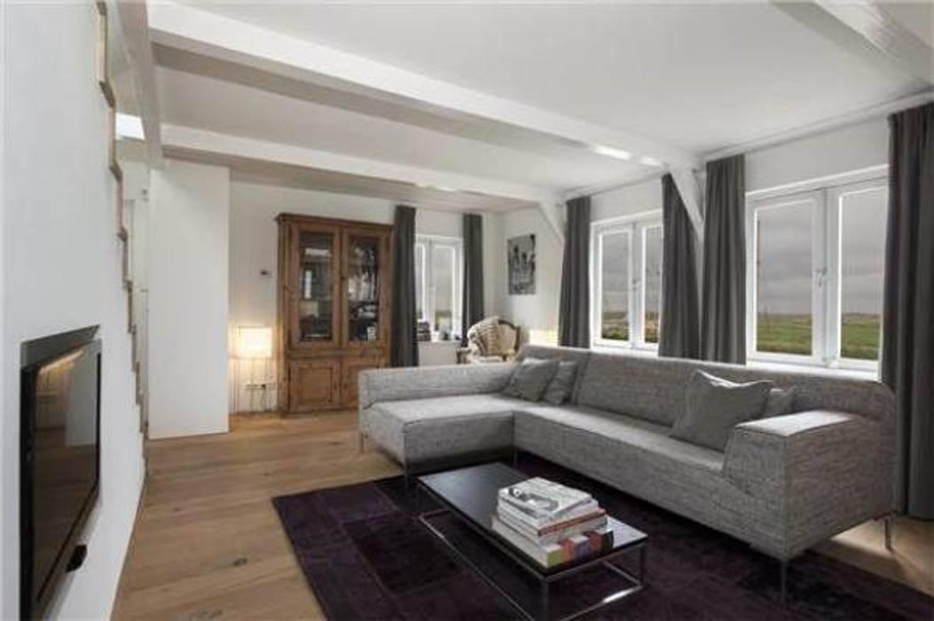 living Moderne woonkamers van Dineke Dijk Architecten Modern