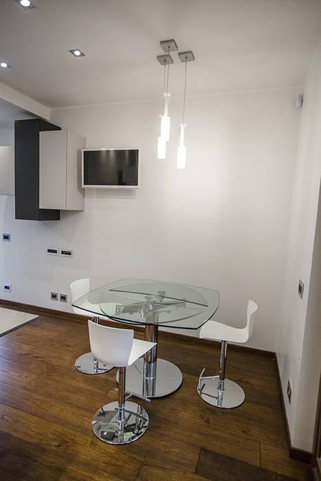 Cucina - angolo pranzo: Cucina in stile in stile Moderno di Archihouse