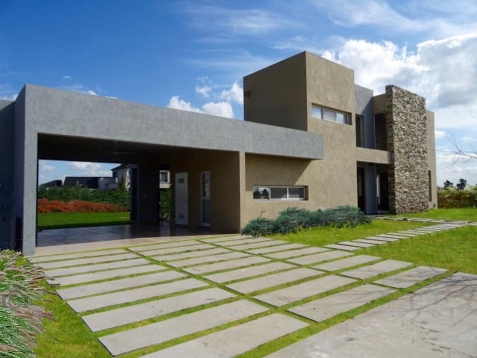 Casa minimalista en San VIcente: Casas unifamiliares de estilo  por Estudio Dillon Terzaghi Arquitectura - Pilar