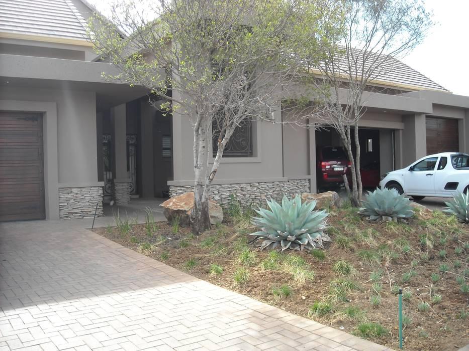 Casas de estilo ecléctico de CKW Lifestyle Associates PTY Ltd Ecléctico