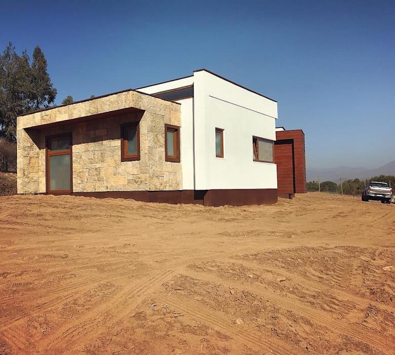 Fachada lateral. Vivienda Lt37 Premium 125m2 Fundo Loreto: Casas unifamiliares de estilo  por Territorio Arquitectura y Construccion