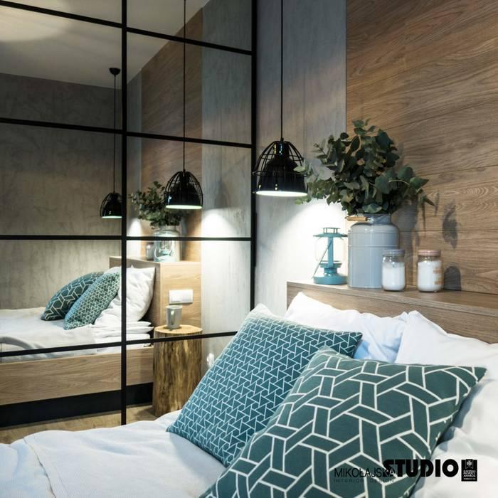 Industrial style bedroom by MIKOŁAJSKAstudio Industrial
