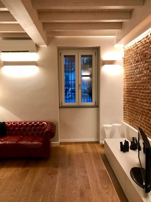 Angolo soggiorno: Soggiorno in stile  di Cozzi Arch. Mauro