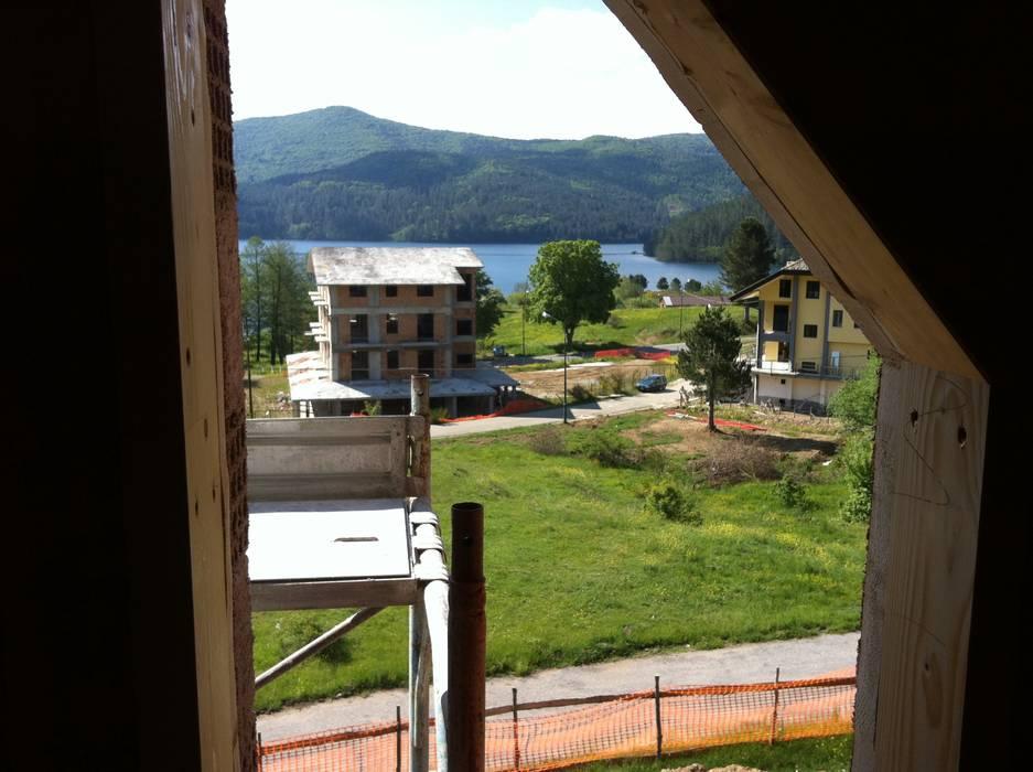Vista lago: Case in stile  di Architetto Giovanni Marra Studio di Progettazione Integrata