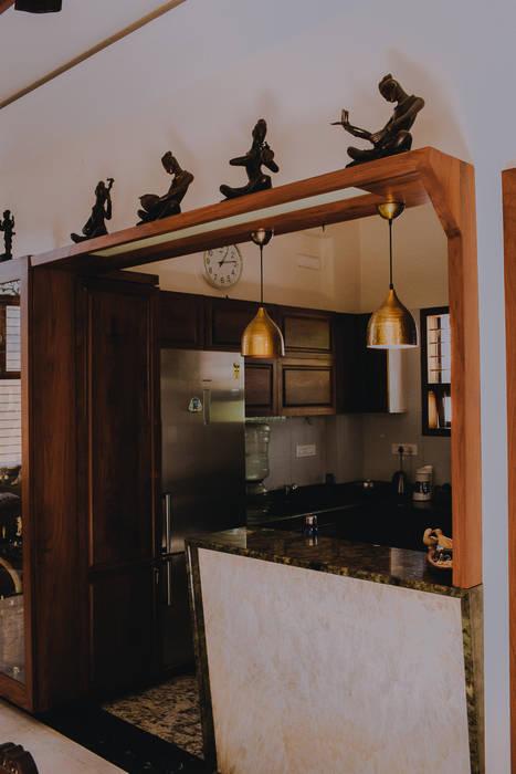 Kitchen Breakfast counter:  Kitchen by Geometrixs Architects & Engineers