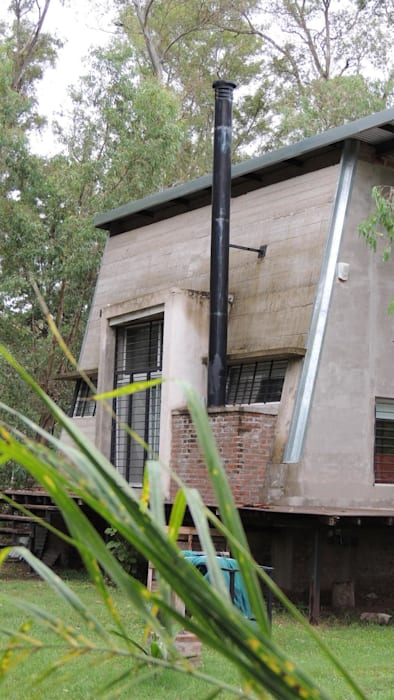 Casa A&P - Vista 2: Jardines en la fachada de estilo  por Módulo 3 arquitectura