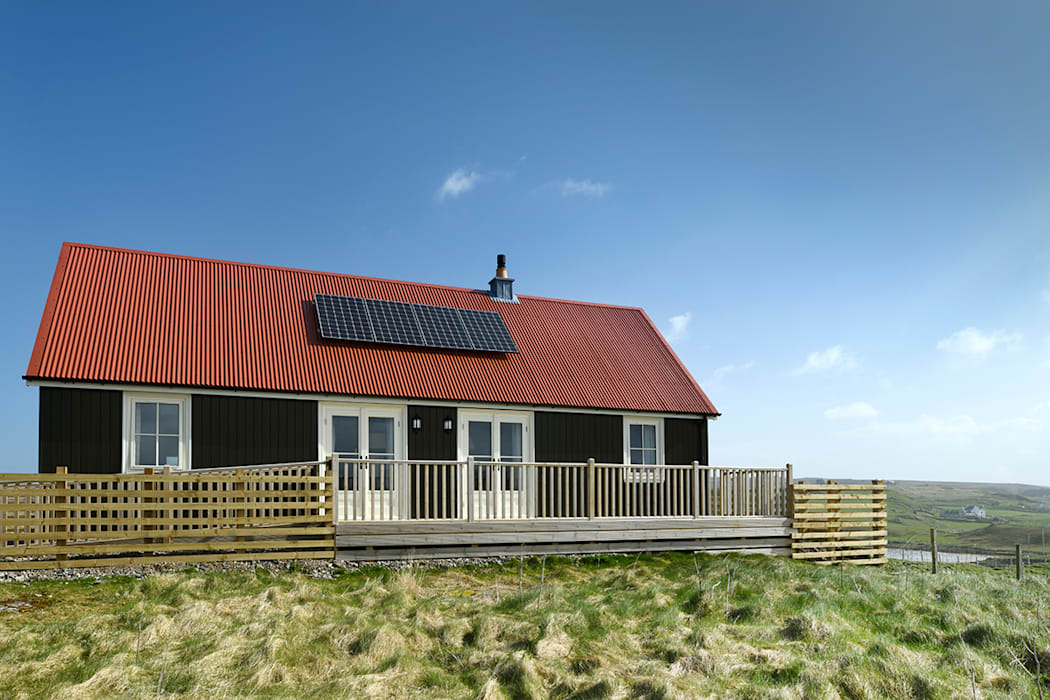 Rear of property with decking and solar panels - Two Bedroom Wee House with solar panels.:  Houses by The Wee House Company