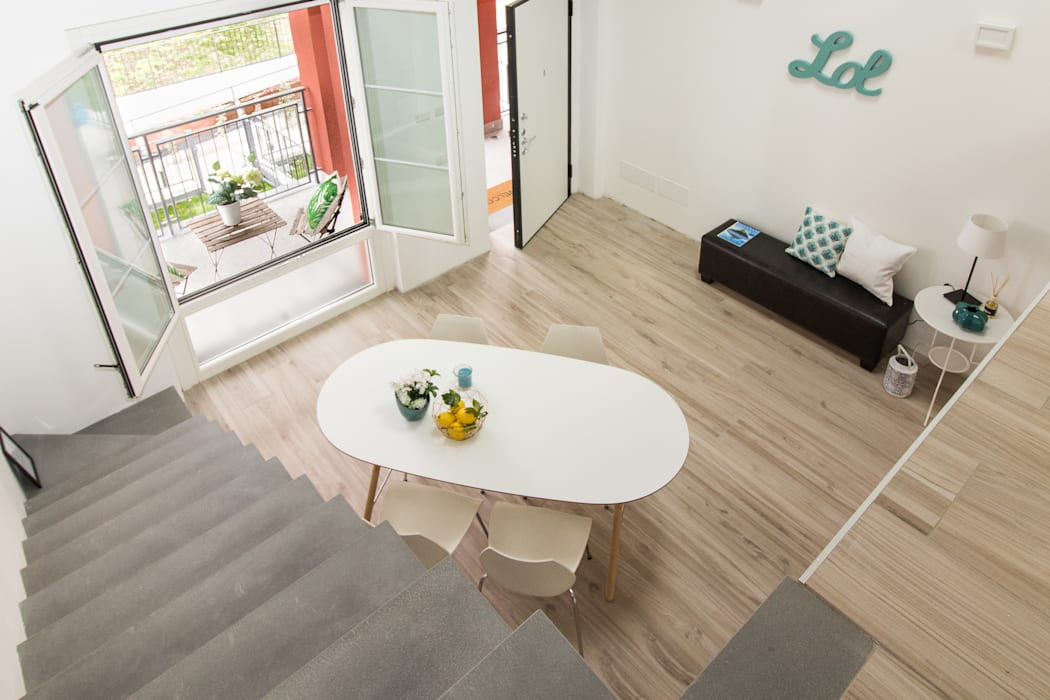 """Home staging di trilocale in vendita - """"I Giardini di Casbeno""""-Varese: Sala da pranzo in stile in stile Moderno di Boite Maison"""