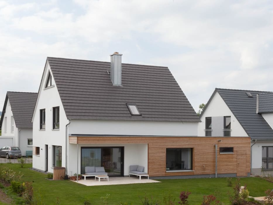 Wooden houses by Herrmann Massivholzhaus GmbH, Modern Solid Wood Multicolored