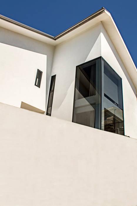 Maison individuelle de style  par Eurico Soares Teixeira Arquiteto - Unipessoal, Lda