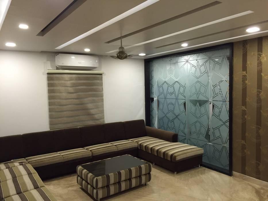 モダンデザインの リビング の Vdezin Interiors モダン
