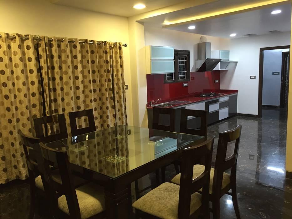 PLUSH & LAVISH VILLA:  Dining room by Vdezin Interiors