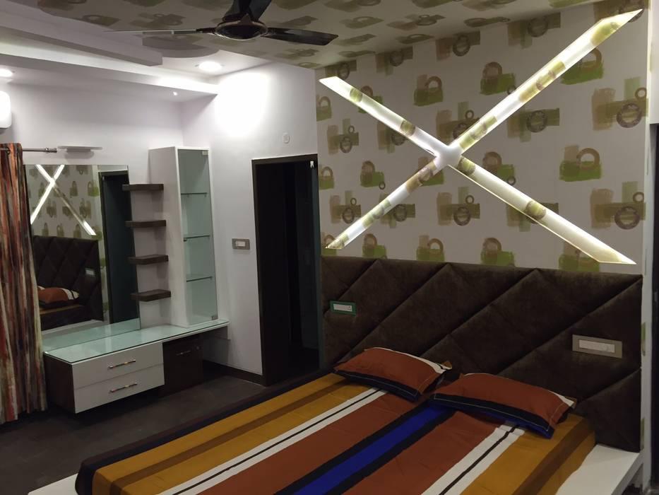 PLUSH & LAVISH VILLA:  Bedroom by Vdezin Interiors