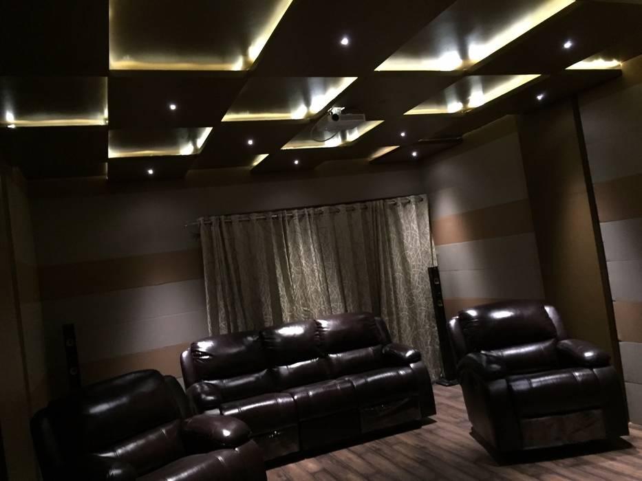 PLUSH & LAVISH VILLA:  Media room by Vdezin Interiors