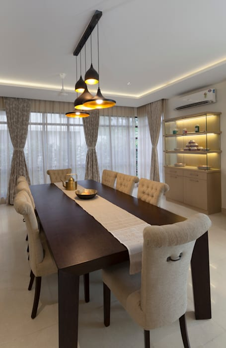 Residence No.1 at Panache, chennai:  Dining room by Synergy Architecture and Interiors,