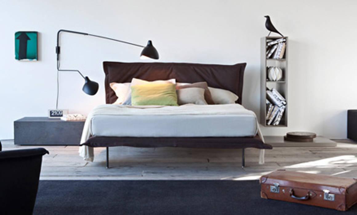 Tendaggi e Tappezzeria interno ed esterno: Camera da letto in stile  di Drim Casa