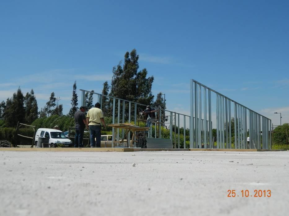 Casa siding Isla de Maipo Paredes y pisos de estilo mediterráneo de AG Gestión Mediterráneo