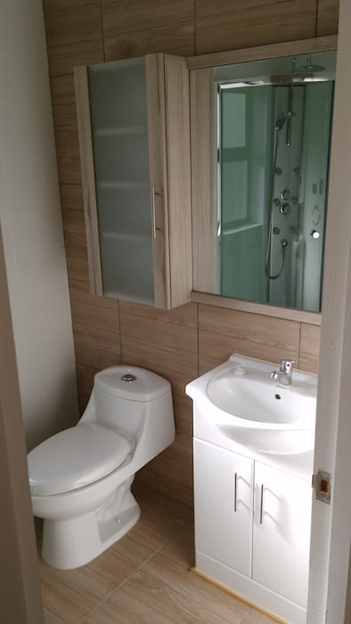 Casa Gral.Cruz Baños de estilo moderno de Lau Arquitectos Moderno