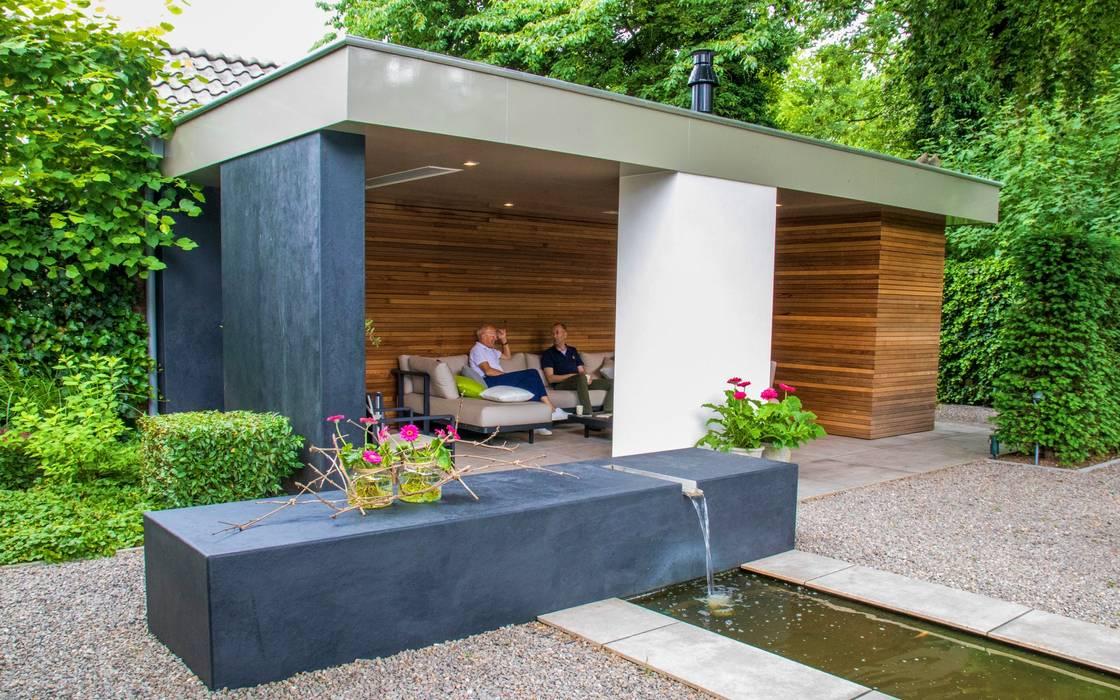 Sfeervolle moderne tuin met veranda: tuin door stoop tuinen homify