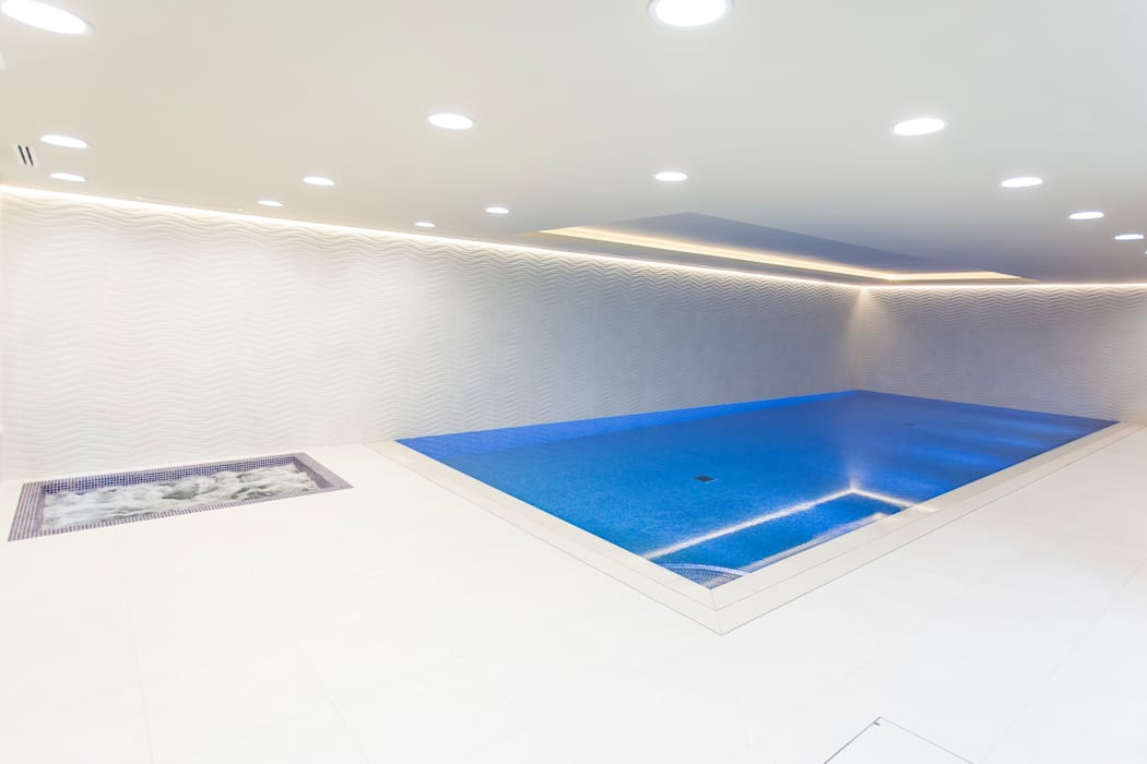 Luxury basement pool and spa by London Swimming Pool Company Minimalist Concrete