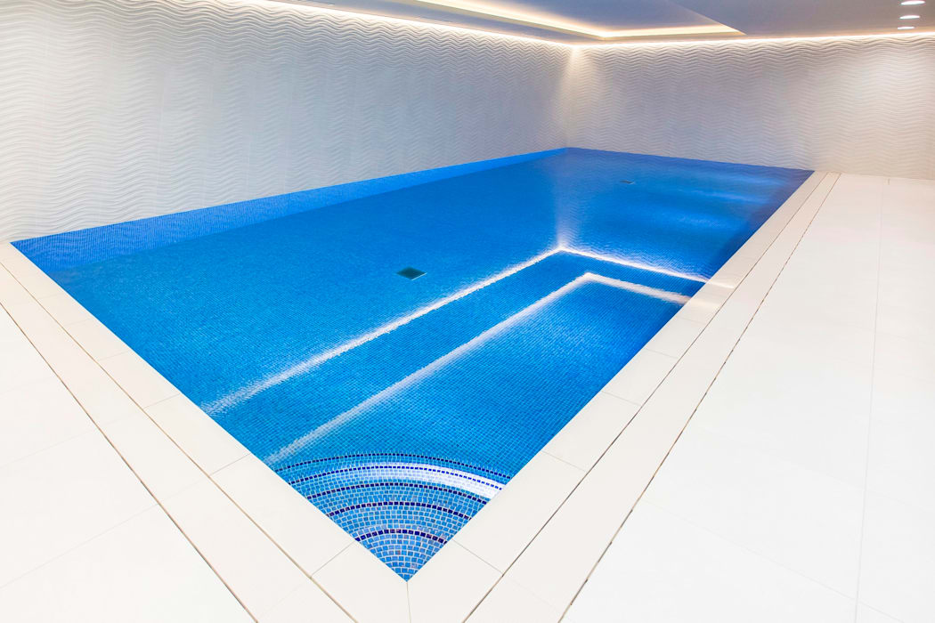 Luxury Basement Pool by London Swimming Pool Company Minimalist Concrete