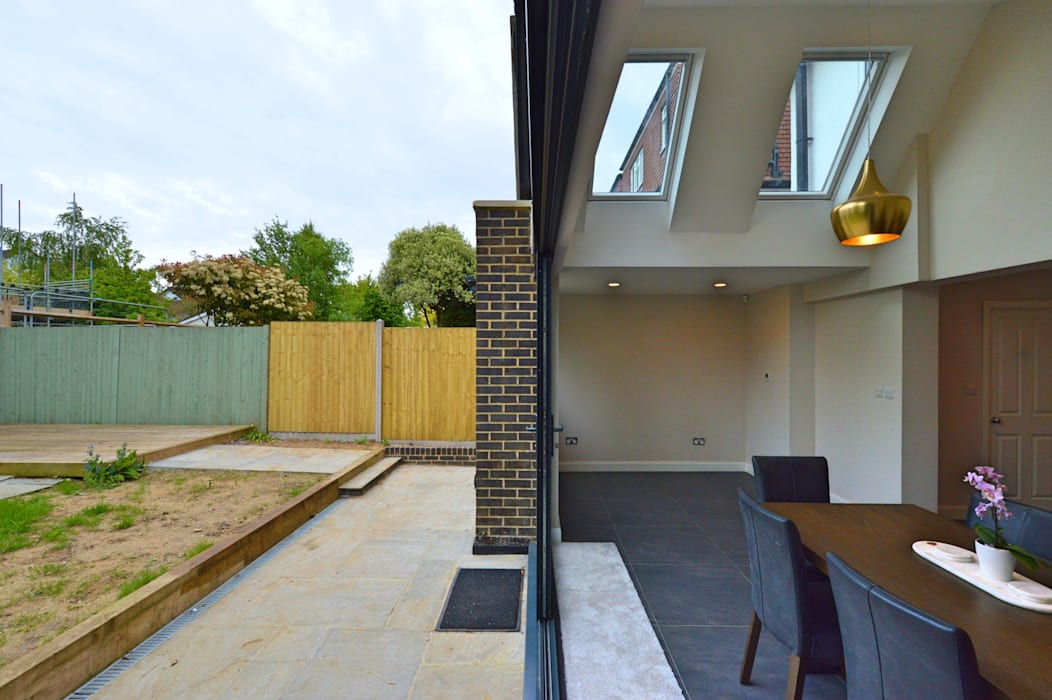 Architect designed roof and kitchen house extension Kingston KT2 - Inside out:  Dining room by GOAStudio | London residential architecture